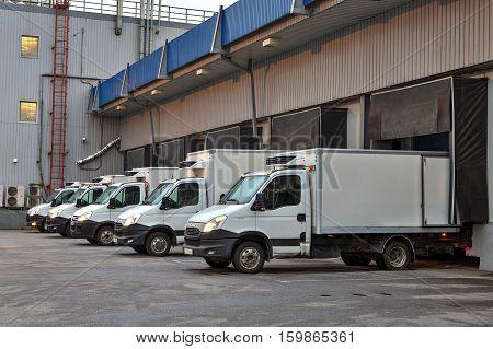 Saint-Petersburg Russia - October 31 2016: trucks fleet at loading dock shipping industry.