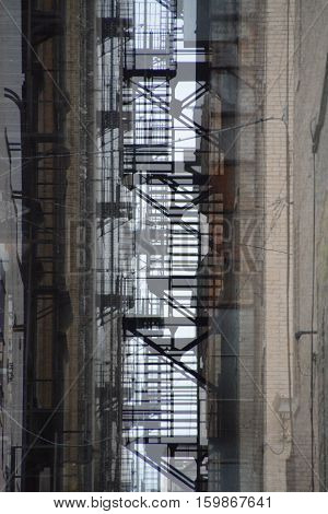 This is an abstract photo of fire escapes in an alley.