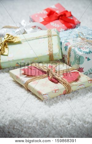 Various Christmas presents in home white, red