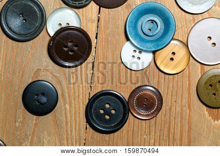 Buttons Lying On Old Wooden Floor.