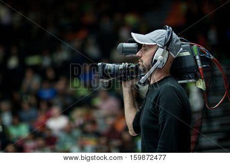 VALENCIA, SPAIN - DECEMBER 3: TV camera operator during spanish league match between Valencia Basket and Bilbao Basket at Fonteta Stadium on December 3, 2016 in Valencia, Spain