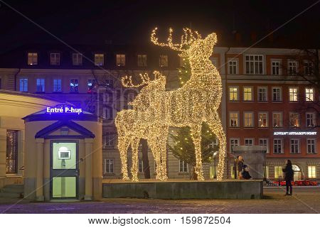 STOCKHOLM SWEDEN - DEC 03 2016: Christmas reindeer made of led light in front of a building during night Norra bantorget Stockholm Sweden