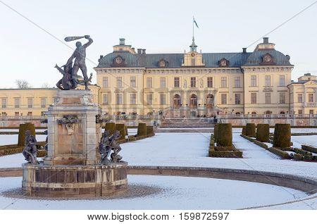 STOCKHOLM SWEDEN - DEC 03 2016: Statues and the swedish royal castle Drottningholm during the winter. Norra bantorget Stockholm Sweden