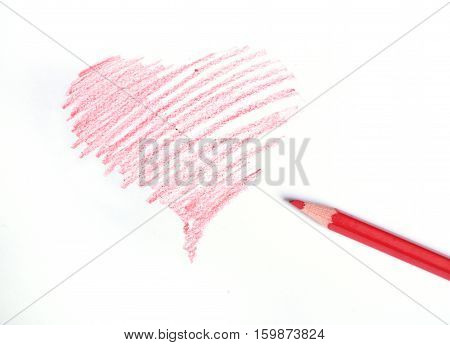Heart drawn by a red pencil on a white background
