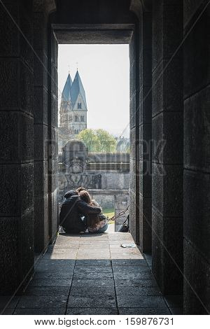 Koblenz Germany April 22 2015: love couple with on the background the Sint Kastor basilica in Koblenz.