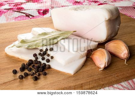 salo, becon with pepper and garlic on the table