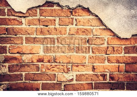 Vintage brick wall with cracked concrete background