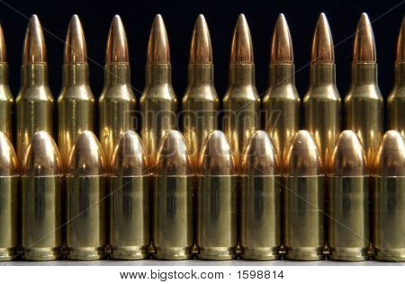 Rifle And Handgun Bullets Lined Up In A Row
