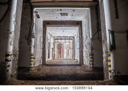 Entrance gateway corridor of abandoned and rusty old soviet military bunker warehouse of chemicals