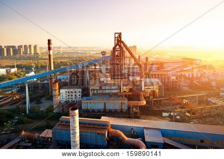constructions in modern power station at sunrise