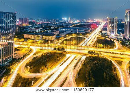 illuminated road junction in midtown of hefei,anhui at twilight