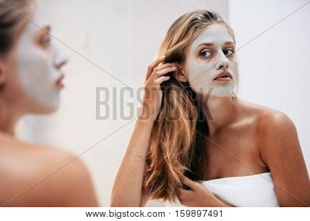 Female With Facial Cosmetic Mask