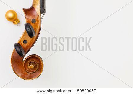 Top view close up shot of old violin and Christmas decoration. Flat Lay Image