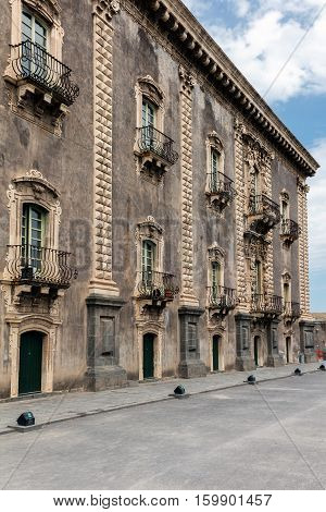 CATANIA ITALY - AUGUST 17 2016: 18th century facade of the Benedictine Monastery of San Nicolo l'Arena in Catania Sicily Italy a jewel of the late Sicilian Baroque style.