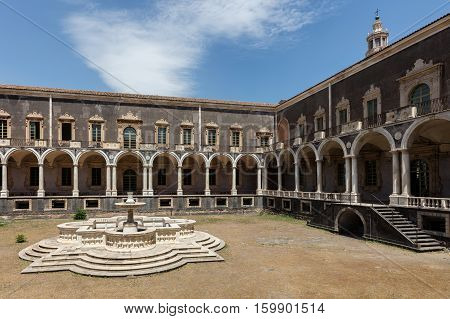 CATANIA ITALY - AUGUST 17 2016: Cloister of the Benedictine Monastery of San Nicolo l'Arena in Catania Sicily Italy a jewel of the late Sicilian Baroque style.