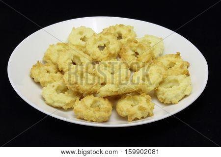 Isolated white plate with special czech christmast cookies x-mas sweets like butter tea cookies made of butter and coconut