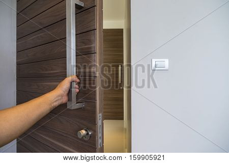 abstract scene of hand on silver handle for open the door to welcome someone into room - can use to display or montage on product