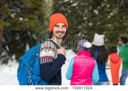 Man With Rucksack People Group Snow Forest Young Friends Walking Outdoor Winter Pine Woods
