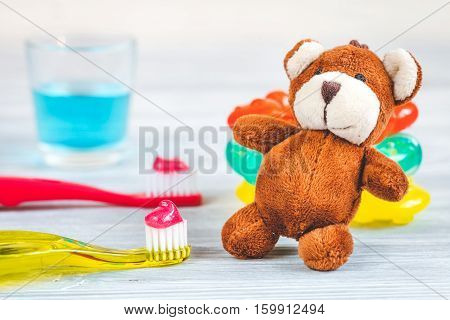 children's toothbrush oral care on wooden background.