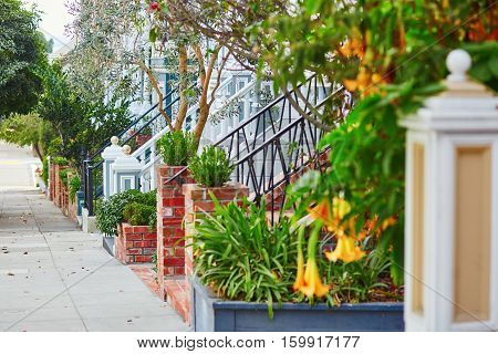 Beautiful Porches Of Wooden Houses On Street Of San Francisco