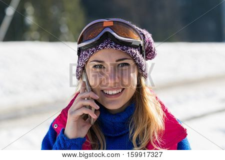 Young Girl Speak Smart Phone Tourist Snowboard Ski Resort Snow Winter Mountain Smiling Woman Holiday Extreme Sport Vacation