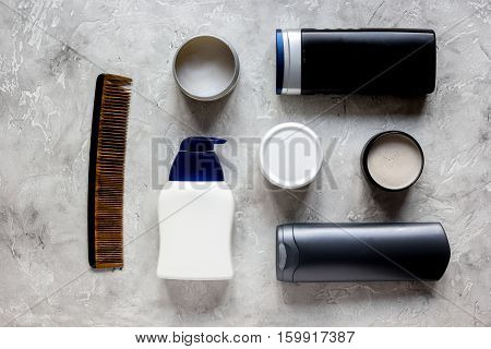 mens cosmetics for hair in bottle at gray background top view