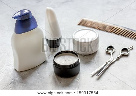 mens cosmetics for hair in bottle at bathroom close up