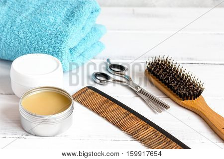Men's cosmetics for hair care on wooden background close up