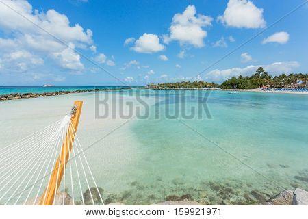 Empty hammock on tropical beach in flamingo island. Aruba