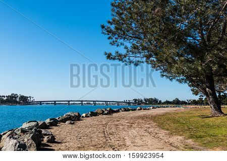 Rock-lined trail at Vacation Isle Park on Mission Bay in San Diego, California.