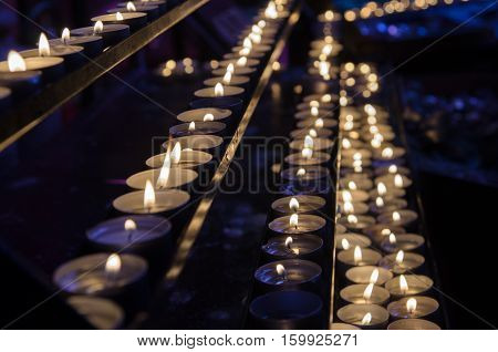 Candles in several rows at St. Stephen's Cathedral (Stephansdom). Vienna. Austria