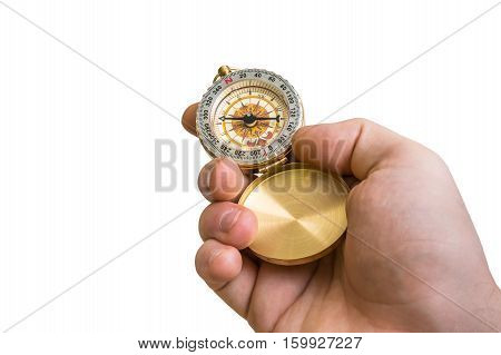 Antique Brass Compass In A Hand Isolated On White