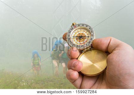 Traveler Man With Compass Seeking A Right Way Through The Fog