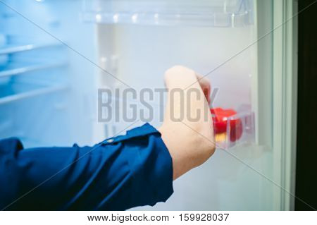 Housewives Hand Arranges Purchased Vegetables In The Refrigerator