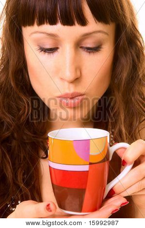 attracive girl with cup of hot tea. close up