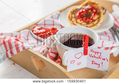 Breakfast for valentines day - pancaked, jam and coffee, copy space