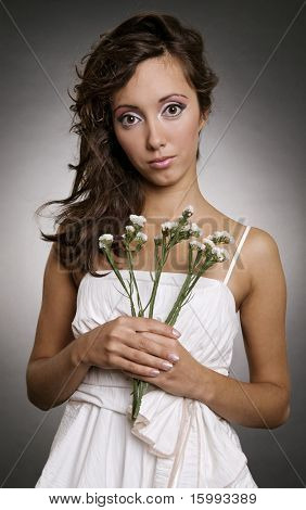 beautiful woman in white dress with flowers