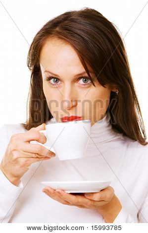 attractive woman drinking coffee over white background