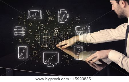 Man pressing table tablet hand touch interface with media icons and symbols