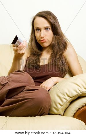 bored woman watching tv and there is nothing interesting