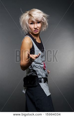dissatisfied casual woman over dark background