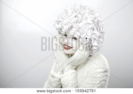 Portrait Of A Cute Girl With A White Face And Curly Hair..