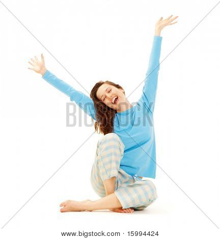 happy young woman in blue pyjamas isolated on white background