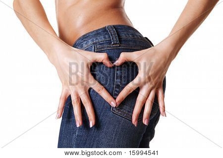 woman hands showing heart shape over blue jeans