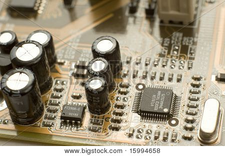 Capacitors And Microchips On Circuit Board