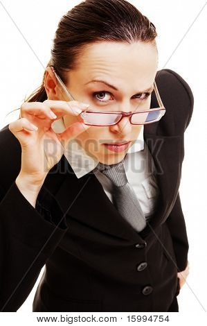 curious businesswoman holding her glasses against dark background