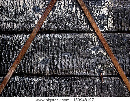 Burnt broken wood wall background texture, natural pattern