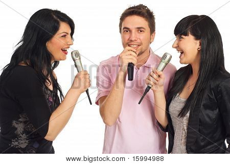 Happy Friends Singing At Karaoke Party