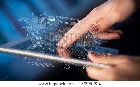 Female hands touching tablet with maps and charts