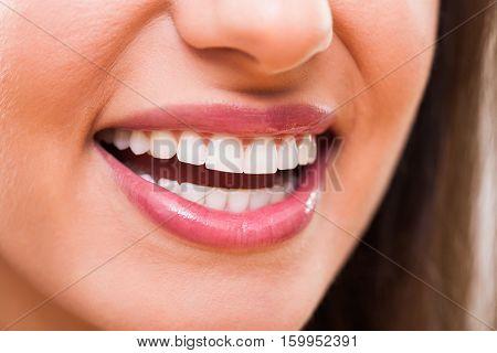 Close up image of perfect female teeth.
